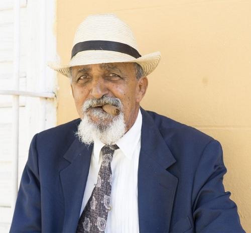 Man with cigar. (Photo copyright June Eichbaum)