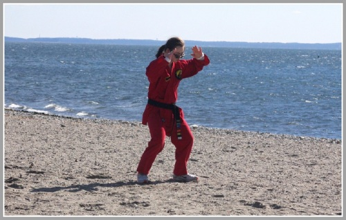 Bella Rizzi prepares for her final black belt test, last Sunday at a very cold Compo Beach.